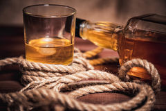 Whiskey aged elite alcohol on wooden background Royalty Free Stock Photography