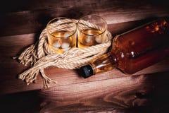 Whiskey aged elite alcohol on wooden background Stock Images