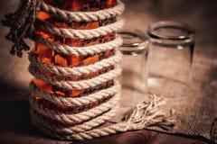 Whiskey aged elite alcohol on wooden background Royalty Free Stock Photo