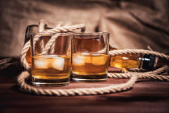 Whiskey aged elite alcohol on wooden background Royalty Free Stock Image