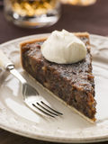 Whiskey And Dried Fruit Tart With Whipped Cream Royalty Free Stock Photography