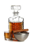 Whiskey and ashtray. Glass jars with whiskey and cigar on white background royalty free stock photography