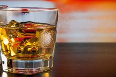 Whiskey on bar table with ice with space for text Royalty Free Stock Photo