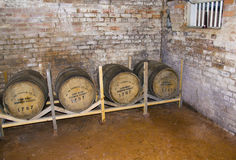 Whiskey Barrels. Old whiskey barrels in the cellar of an early 19th century American house Royalty Free Stock Photo