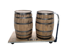 Whiskey beer barrels on cart. Two wooden whiskey barrels on a cart isolated on white Royalty Free Stock Photo