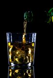 Whiskey being poured Royalty Free Stock Photos