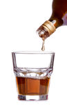 Whiskey being poured into a glass Royalty Free Stock Image