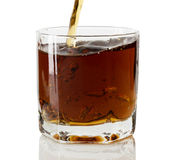 Whiskey being poured into a glass Royalty Free Stock Photos