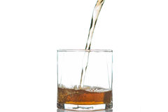 Whiskey being poured into a glass Royalty Free Stock Images