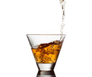 Whiskey being poured into a glass Stock Photography