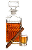 Whiskey and big cigar. Glass jars with whiskey and cigar on white background royalty free stock photos
