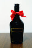 Whiskey Bottle. Black Whiskey Bottle With A Red Bow Royalty Free Stock Photos
