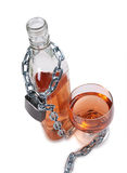 Whiskey bottle and chain Royalty Free Stock Photography