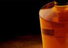 Whiskey bottle on dark wood table background Royalty Free Stock Images