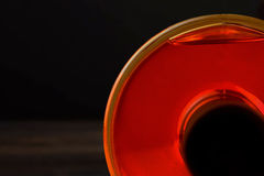 Whiskey bottle on dark wood table background Stock Image