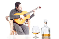 Whiskey bottle and glass Stock Photography