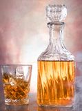 Whiskey bottle with glass royalty free stock image