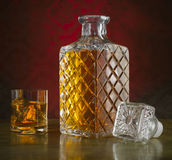 Whiskey in bottle and glass with ice Stock Photo
