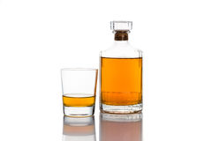Whiskey bottle with a glass of whiskey in white background Stock Photos