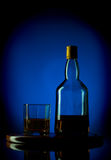 Whiskey bottle and glass on wooden tray Stock Photo
