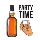 Whiskey bottle and hand holding full shot glass Stock Photography