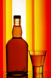Whiskey bottle and shot glass Royalty Free Stock Photo