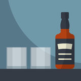 Whiskey bottle with two glasses empty. Stock Photography