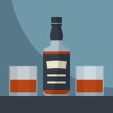 Whiskey  bottle with two glasses filled. Stock Photos