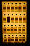 Whiskey bottles. In row at the closet stock photos
