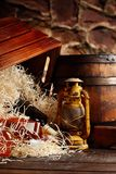 Whiskey bottles. Posterous, inverted vintage whiskey wooden containers box, kerosene lantern style oil lamps, wooden barrel. Still. Life. Copy space royalty free stock photography