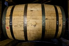 Whiskey or bourbon barrel aging in a distillery warehouse Stock Images