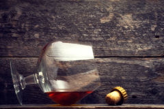 Whiskey, bourbon, brandy, or cognac on log table. Strong alcohol in the glass Stock Photo