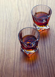 Whiskey, bourbon, brandy, or cognac on log table. Strong alcohol in te glass Royalty Free Stock Photography
