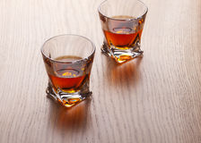 Whiskey, bourbon, brandy, or cognac on log table. Strong alcohol in te glass Royalty Free Stock Image