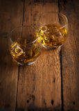 Whiskey, bourbon, brandy, or cognac on log table. Strong alcohol in te glass Stock Photo