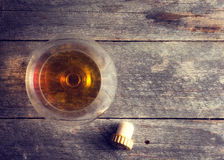 Whiskey, bourbon, brandy, or cognac on log table. Strong alcohol in te glass Royalty Free Stock Photo
