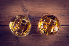 Whiskey, bourbon, brandy, or cognac on log table. Strong alcohol in te glass Royalty Free Stock Images