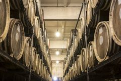 Whiskey and brandy distillery. Scotch Whisky Barrel rows. Whiskey and brandy distillery. Oak barrel used to age whiskey stock photo