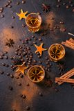 Whiskey, brandy or liquor, spices, anise stars, coffee beans, ci. Whiskey, brandy or liquor, coffee beans, spices and decorations on dark background. Seasonal Stock Images