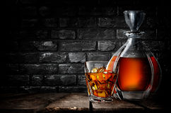 Whiskey and brick wall Stock Images