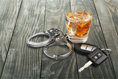 Whiskey with car keys and handcuffs concept royalty free stock images