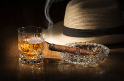 Whiskey and cigar. Cuban style rum and cigar close up Royalty Free Stock Photo