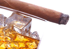 Whiskey and Cigar. Whiskey in Glass of Ice with cigar isolated over white Royalty Free Stock Photography