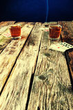 Whiskey, cigar and cards on a wooden background Stock Photo