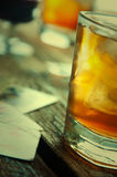 Whiskey, cigar and cards on a wooden background Royalty Free Stock Image