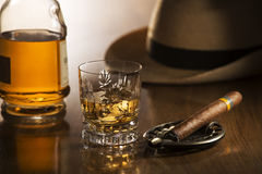 Whiskey. And cigar on wooden background close up stock photography