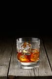 Whiskey. Close up of glass of whiskey on a wood background Stock Image
