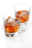 Whiskey. Close up of glasses of whiskey on a white background Stock Image