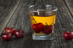 Whiskey Cocktail With Cherries Stock Photo