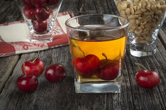 Whiskey Cocktail With Cherries and Peanuts Stock Photography